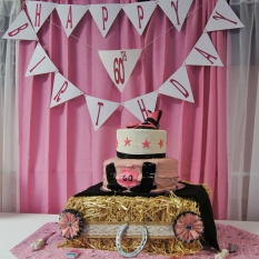 Pink western cake, table and Happy 60th birthday banner