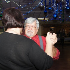 Lisa and Larry are dancing